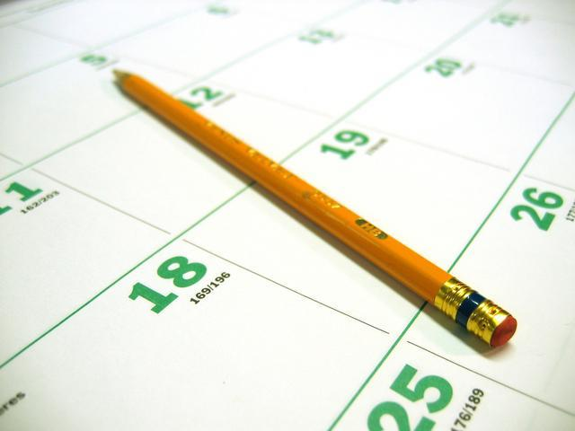 A pencil rests on a calendar